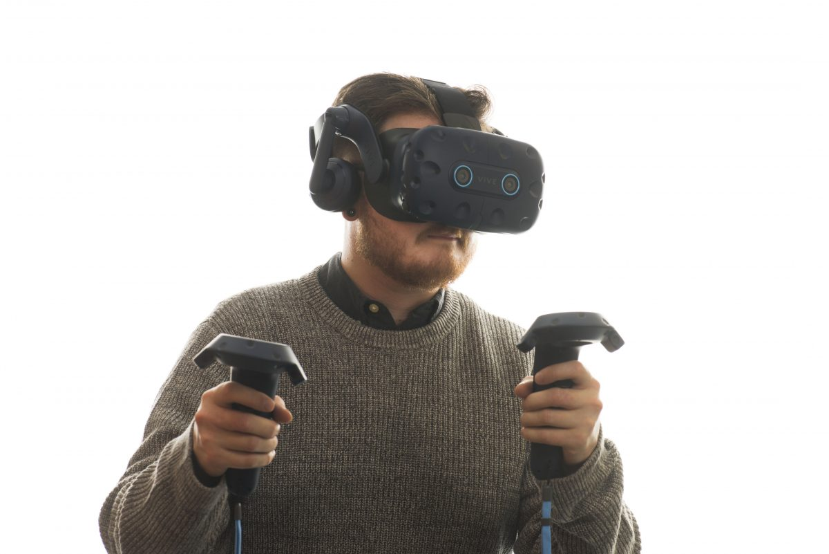 Young man wearing vive headset for virtual and augmented reality experience