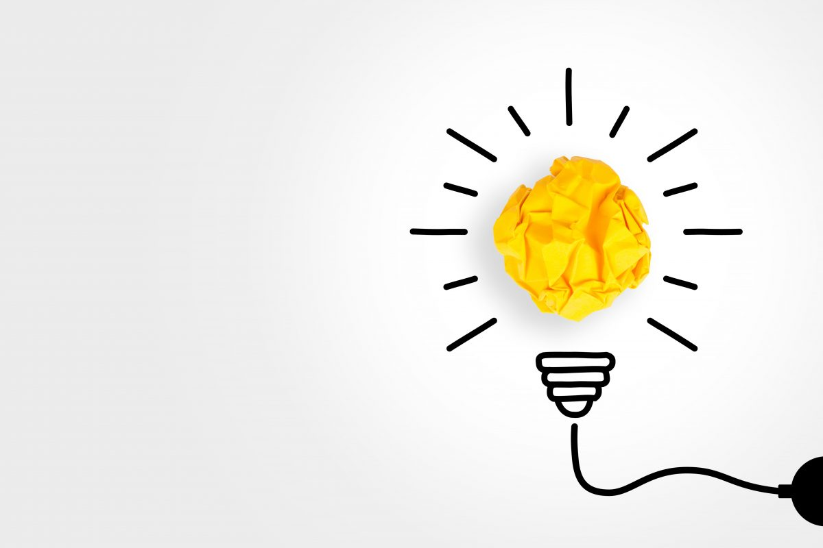 Ball of yellow paper made to look like the lightbulb of an innovative idea.