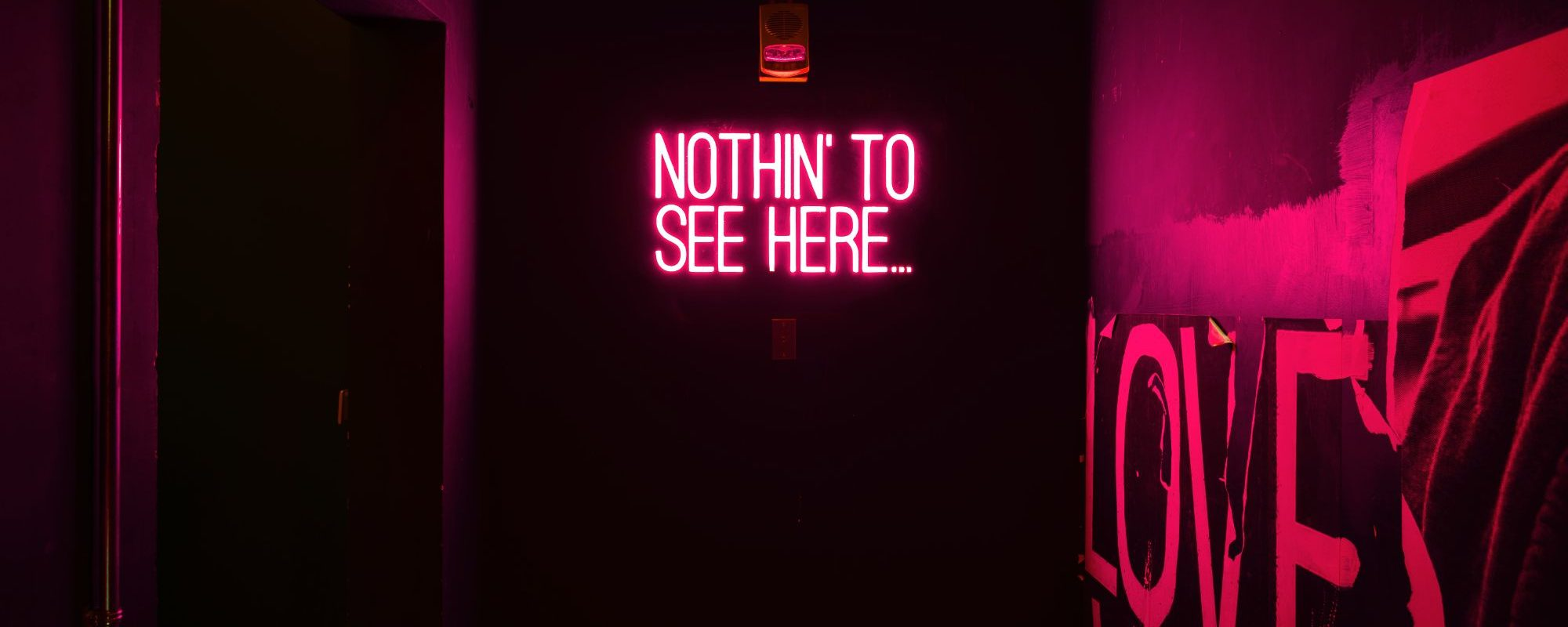 A neon sign saying 'nothing to see here'